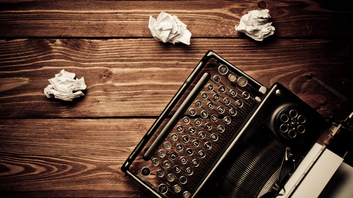 image of old typewriter and wadded up paper balls